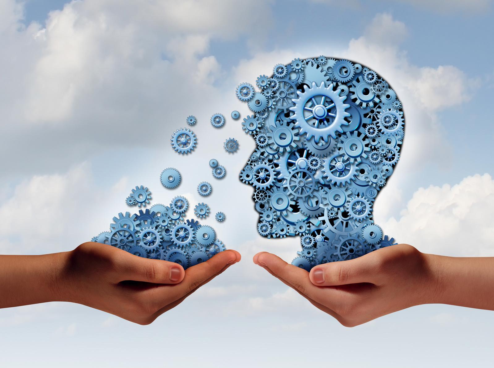 Zahnräder die sich von einem Kopf in eine Hand bewegen als Symbol für den Wissenstransfer bei einer Beratung zu einem Qualitätsmanagementsystem und der ISO 9001 Zertifizierung